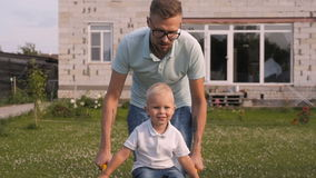 Happy Dad Having Fun With His Little Smiling Son In The Garden stock footage