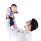 Happy dad holds and lift up his baby Stock Image