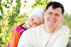 Happy dad hugging his little daughter Royalty Free Stock Photos