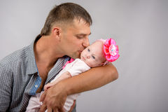 Happy dad kissing a two-month baby daughter Stock Photo