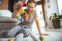 Happy dad playing with his baby at home royalty free stock photos