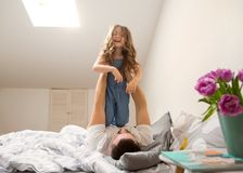 Happy dad playing with his daughter at home, father`s day stock image