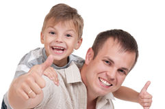 Happy dad and son. Portrait of happy dad and son isolated on white background Royalty Free Stock Photography