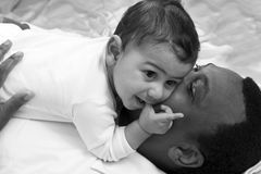 Happy dad and son. Portrait with happy dad and baby boy laying Royalty Free Stock Photos