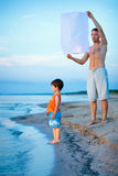 Happy dad and son flying fire lantern together Stock Image