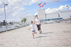 Happy dad and son flying a kite together. A happy dad and son flying a kite together Royalty Free Stock Image
