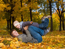 Happy dad and son in a yellow autumn park Royalty Free Stock Photography