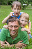 Happy dad with two children Royalty Free Stock Photos