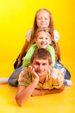 Happy dad with two daughters Royalty Free Stock Photos