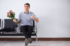 The happy dad waiting for news in maternity house. Happy dad waiting for news in maternity house Royalty Free Stock Photo