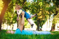 Happy daddy with baby in a greenl summer park Royalty Free Stock Photos
