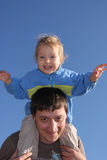 Happy the daddy with a daughter against the sky Stock Photography