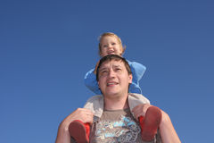 Happy the daddy with a daughter against the sky Royalty Free Stock Photo