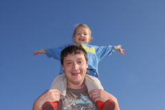 Happy the daddy with a daughter against the sky Royalty Free Stock Image
