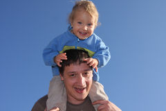 Happy the daddy with a daughter against the sky Stock Images