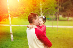 Happy daddy with daughter playing in summer sunny day Royalty Free Stock Photography