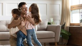 Free Happy Daddy Glad To See Small Kids Sisters After Separation. Stock Photo - 178124480
