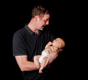 Happy daddy holding baby Royalty Free Stock Image