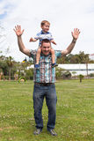 Happy daddy and son having fun outdoors Royalty Free Stock Image