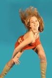 Happy dancer. Happy young woman with hair flying whilst dancing Stock Image