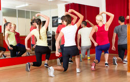 Happy dancers exercising in gym Stock Images