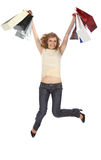 Happy dancing  blonde holds paper bags Royalty Free Stock Image