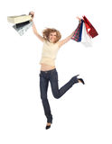 Happy dancing  blonde with paper bags Stock Image