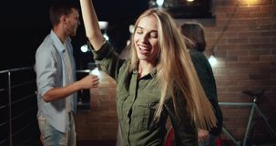 Happy dancing blonde woman on party
