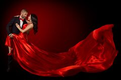 Happy Dancing Couple Portrait, Woman in Red Silk Gown and Handsome Beard Man in Suit, Flying Waving Fabric