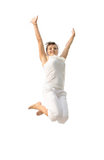 Young happy girl jumping with joy Stock Photos