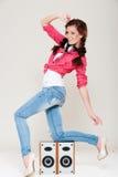 Happy dancing girl with headphones Royalty Free Stock Photo
