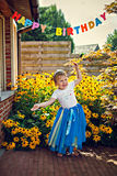 Happy dancing girl in tiara at birthday party Royalty Free Stock Photography