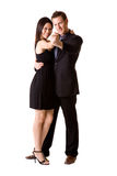Happy dancing pair. A couple in black dancing and feeling very happy Royalty Free Stock Images