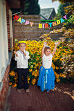 Happy dancing siblings at birthday party Royalty Free Stock Images