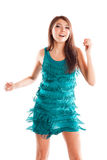 Happy dancing woman in blue dress. Studio shot royalty free stock photography