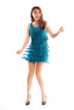 Happy dancing woman in blue dress and black shoes. Studio shot stock images