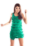 Happy dancing woman in green dress Stock Photos
