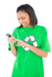 Happy dark haired environmental activist using her mobile phone Stock Photography