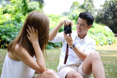 Happy dating couple outdoor picnic with camera Stock Photography