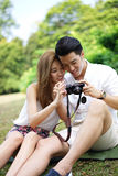 Happy dating couple outdoor picnic with camera Royalty Free Stock Photo