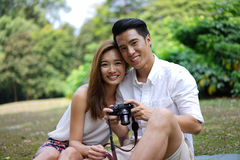 Happy dating couple outdoor picnic with camera Stock Photo