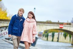Happy dating couple walking in Paris Stock Photo