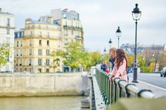 Happy dating couple walking in Paris Stock Photos