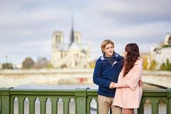 Happy dating couple walking in Paris Royalty Free Stock Photos