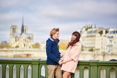 Happy dating couple walking in Paris Stock Images