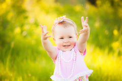 Happy daughter dressed in pink clothes playing at nature Stock Photography