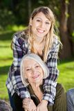 Happy Daughter Embracing Mother At Campsite. Portrait of happy daughter embracing mother at campsite stock photos