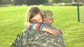 Happy daughter hugging her father-soldier. stock video