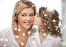 Happy daughter kisses her mother Royalty Free Stock Photos