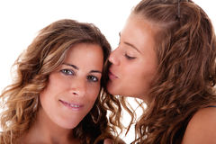 Happy daughter kissing mother Stock Photos